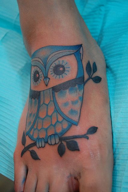 blue owl tattoo on foot