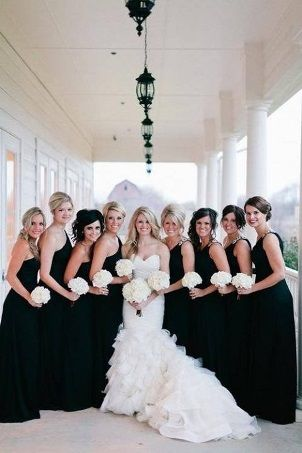 Bride in pure white with black bridesmaids dresses. Gorgeous and classic!