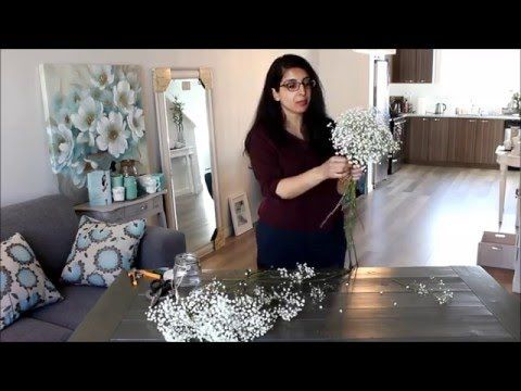 A detailed instructional video that shows viewers how to make a baby's breath bridal bouquet.
