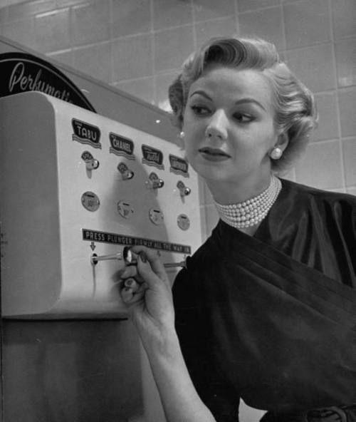 A coin operated perfume dispenser - 1952Nina Leen, Vending Machines, Perfume Vending, 1950S, 1952, 1950 S, Perfume Dispeners, Coins Operation Perfume, Perfume Dispenser