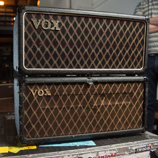 This two-in-one package come from the private collection from Noel Gallagher. This listing is for two 1965 Vox AC50 heads in custom flight case covered in Oasis stickers. These amps have been around the world and back with battle scars to prove it. We're not 100% sure what tours this pair went on, but one head was likely used as the main amp with the second as a backup.