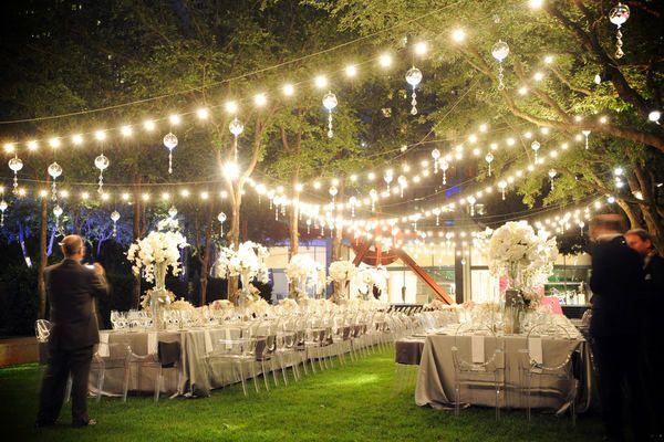 A fairyland of #lights and I love the crystal balls interspersed throughout to help spread the light further. Perfect #outdoor wedding setting.