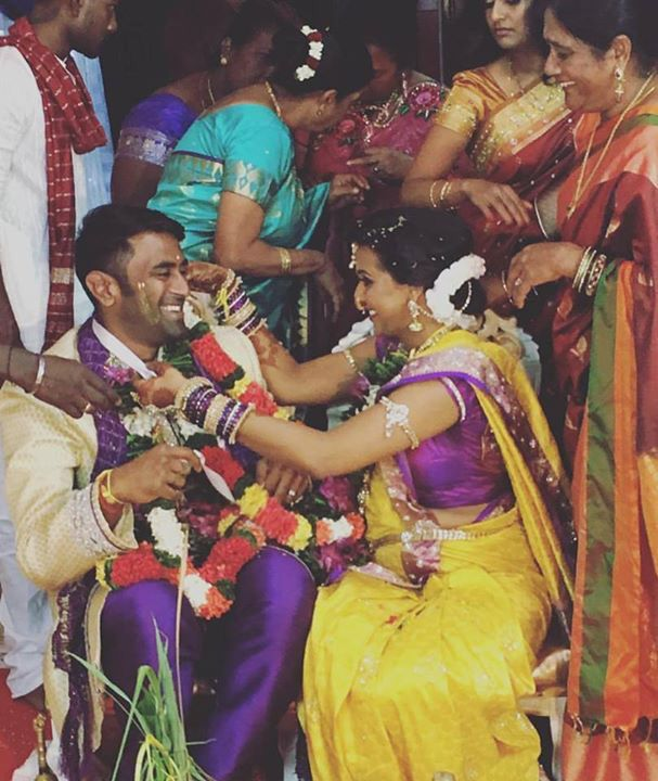 Purple and yellow sari south Indian bride