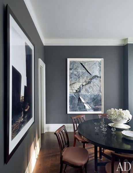 American fashion designer Kasper has long been an avid collector of contemporary art. The steel-gray walls of his Manhattan apartment's dining room beautifully offset works by Edward Burtynsky and Anselm Kiefer | archdigest.com