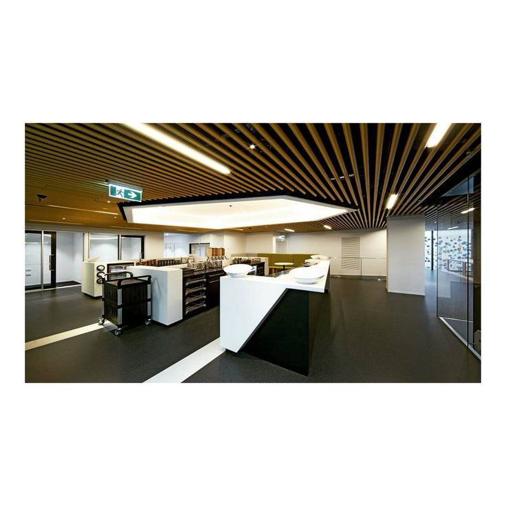 50 Martin Place, Sydney. SAS International provided bespoke metal ceiling solutions, producing individual ceiling bays throughout the office space that were sympathetic to the heritage requirements of the build. SAS130 tiles with large open area and SAS750 Tubeline were specified in the offices and corridors to allow passive chilled beam airflow.