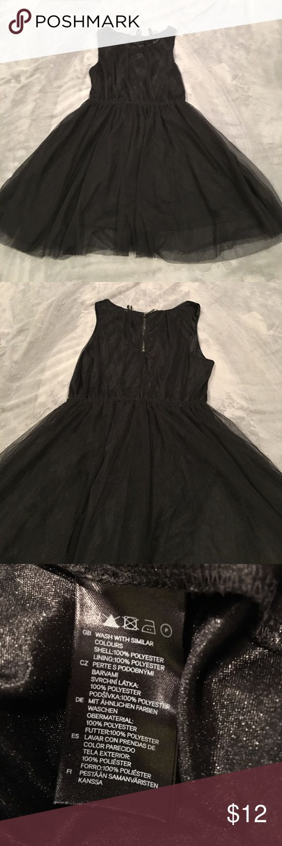 Tulle material dress Dress was purchased from an H&M store. It has a stretchable waist line. The material does not fray on the bottom. It's a nice simple black party dress to throw on. Divided Dresses Mini