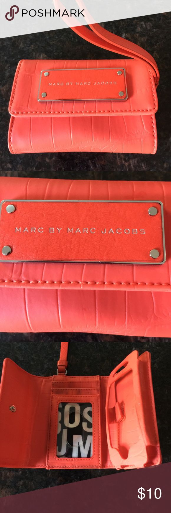 """Marc by Marc Jacobs Orange Phone Wristlet Marc by Marc Jacobs Cell Phone Orange Wristlet, vinyl body with leather strap, some wear on credit card sleeve, and at bottom of c 2 qphone holder show in pictures, snap closer, for smaller phones, 2 1/2""""  x 4 5/8"""". Marc by Marc Jacobs Bags Clutches & Wristlets"""