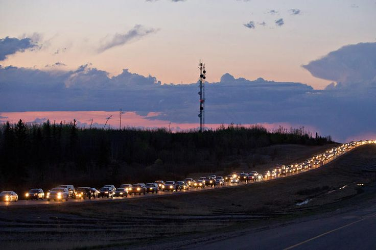 Traffic lines the highway as residents leave Fort McMurray, Alberta, Canada, on May 3, 2016. (Photo by Jason Franson/The Canadian Press/AP)