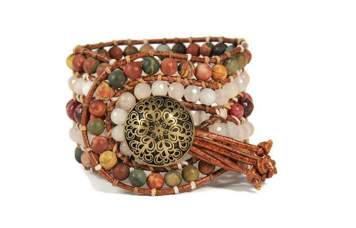 Accessorize with this bracelet to make a statement to your casual or evening look. 5 strands women's bracelet is crafted with beautiful semi precious stones of jade, jasper Picasso & aventurine. All of them are framed by natural brown leather woven together with beige wax cord. This gorgeous design also features a metal, bronze button closure to signature our boho style collection.