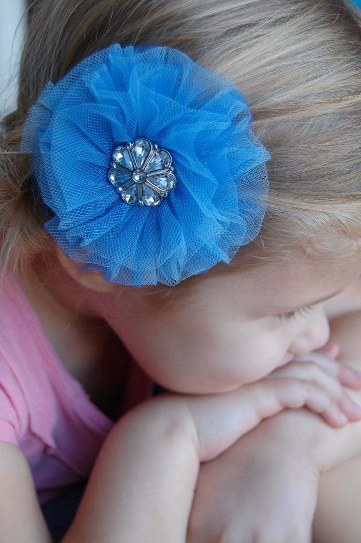 I made this hair bow for a friend whose little girl is turning 1. She wanted it glamorous and princess-y without being too adult. $5 in any color