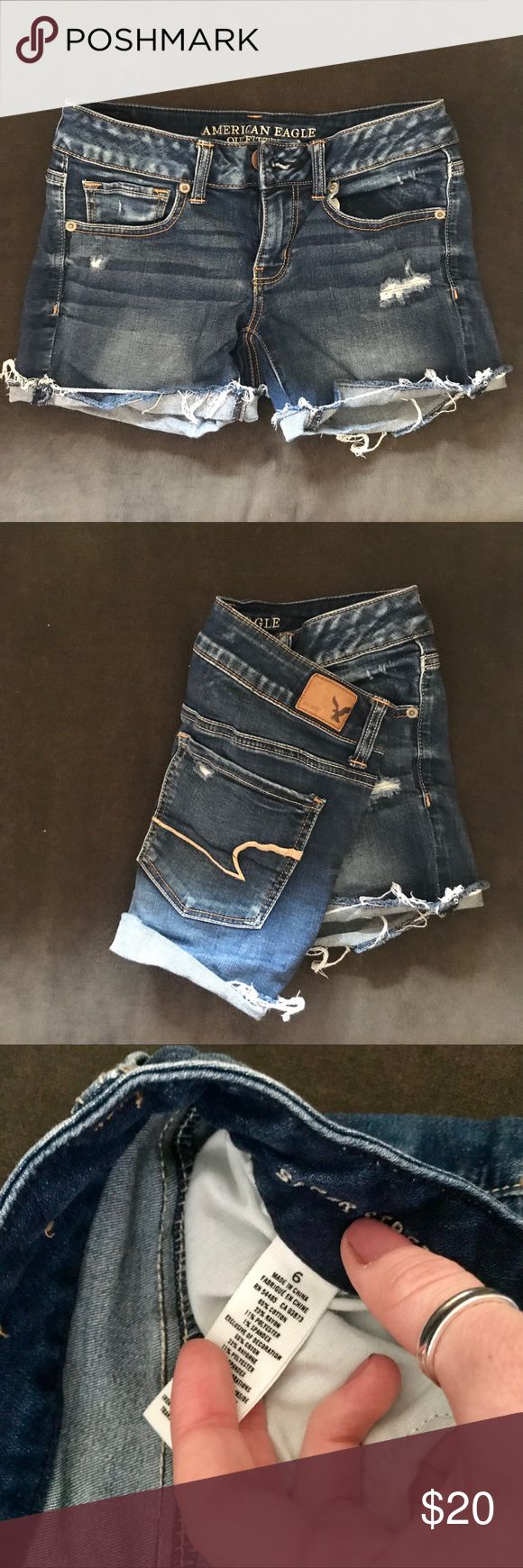 Distressed dark denim shorts AE American eagle distressed denim shorts. Such a cute fit and style. Can be worn with the cuff rolled or unrolled for a little more coverage. Size 6, but I'd say fits size 4-6. Very stretchy denim. American Eagle Outfitters Shorts Jean Shorts