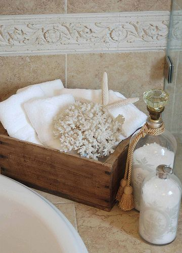 Crate for towels and starfish, glass bottles for bath salts - guest bath