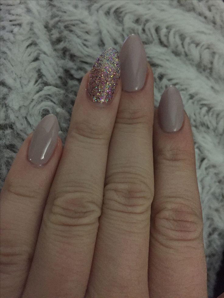 Almond nails--tan/purple with Glitter accent for New Years