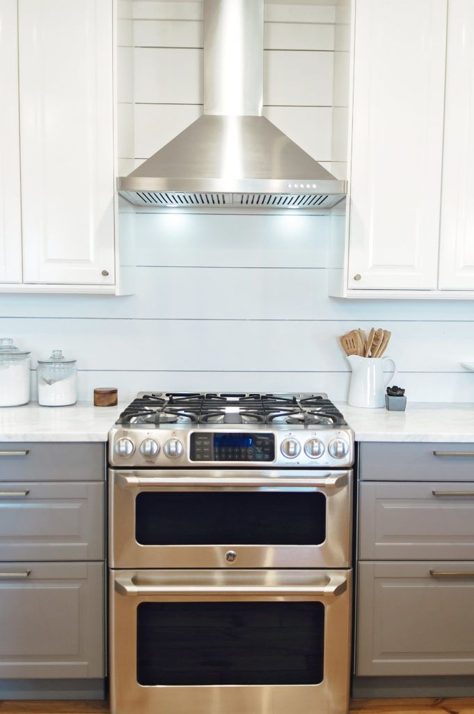 GE Cafe series gas range and double oven. IKEA Bodbyn cabinets in Gray and White