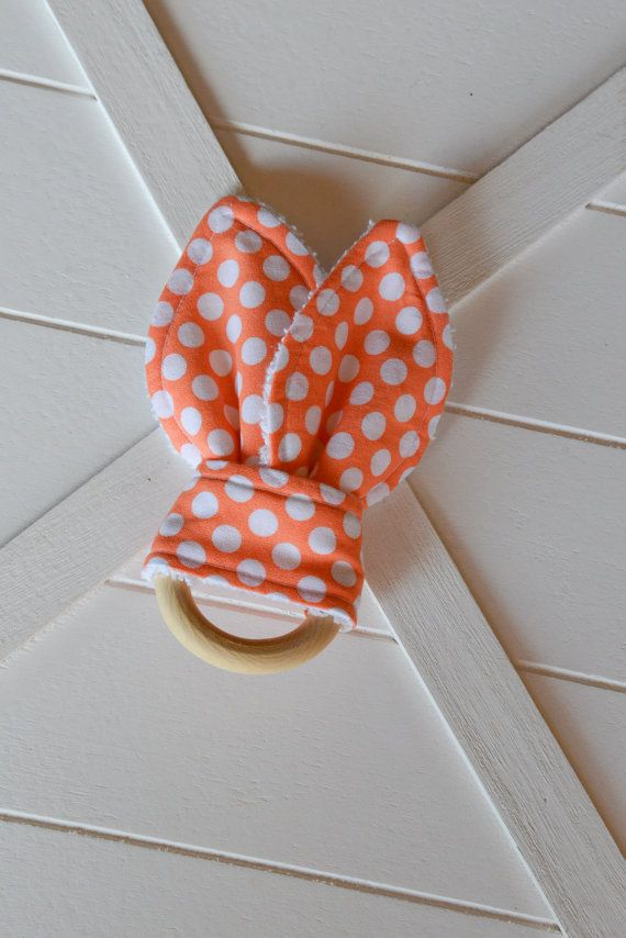 Soft fabric bunny ears teether made from printed cotton, durable cotton terry towelling and natural unfinished wood. Bunny ears are soft and comforting with beautiful prints for your little one to enjoy, and a natural wooden teething ring that will soothe and relieve sore gums. Care Instructions: Fabric bunny ears are removable and are machine washable in cold water on a gentle cycle. Wooden teething ring can be hand washed in warm soapy water and air dried flat. No extra charge for…
