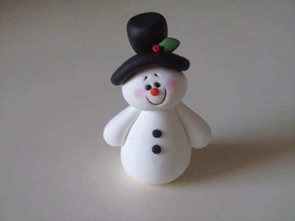 Polymer Clay Christmas Snowman. $8.00, via Etsy.