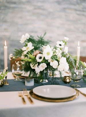 Fairly loose centerpieces still focused on large, classic flowers.  Add in a touch of dark plum and/or navy.