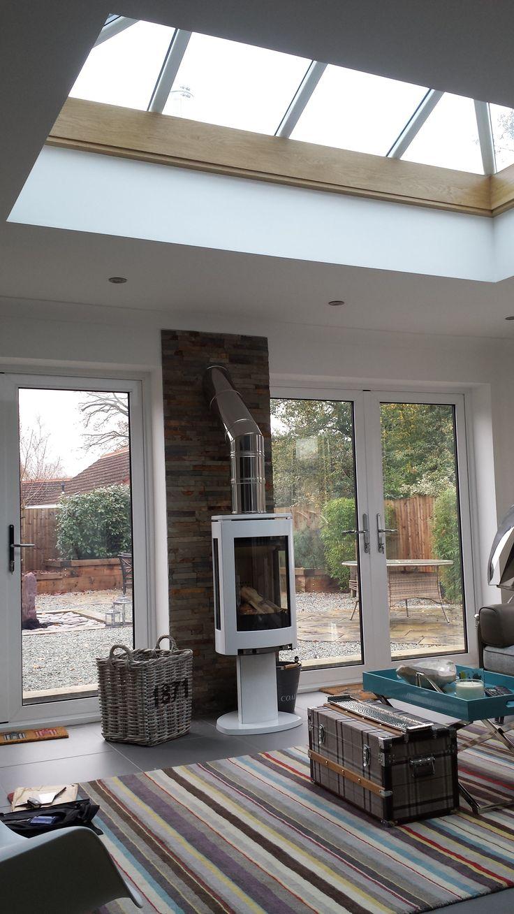 Jotul 373 in white enamel with split faced tiles. http://jotul.com/uk/products/wood-stoves/Jotul-F-373