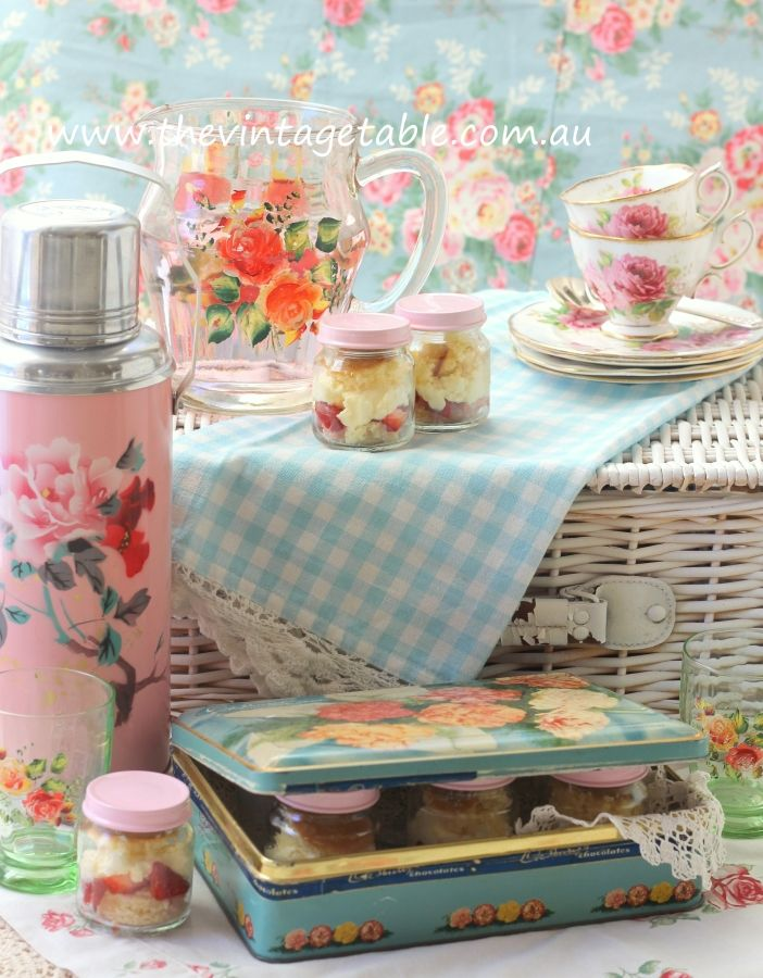 A vintage picnic afternoon tea with strawberry shortcakes in jars.