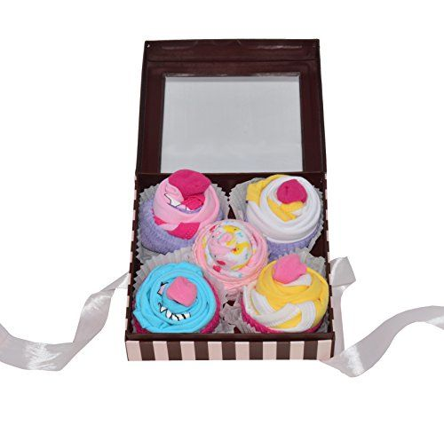 New Baby Clothing Cupcake Gift Set  Beautiful baby gift for celebrating arrival of a new baby, shower gift or party centerpiece. Thoughtful, beautiful and practical - only from Nikki's Gift Baskets.  Quality clothing rolled to look like cupcakes in a keepsake box.  Includes 4 onesies (size 3 - 6 months), 2 socks and 2 wash cloths.  We are the creator and manufacturer of all NIKKI'S GIFT BASKETS products. Be aware that if you order this item from any other vendor, you MAY NOT receive th...