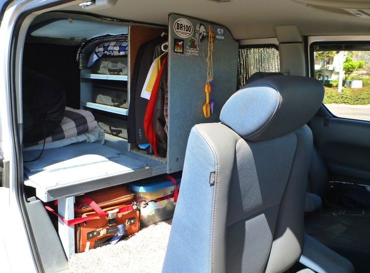 Rear seats removed and camping setup installed.
