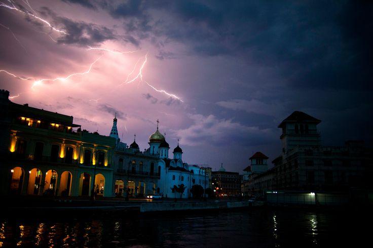 Lightning illuminates the sky over the Malecon during a lightning storm in Havana, Cuba, Wednesday, Sept 19, 2012.   (Photo: Ramon Espinosa / AP)