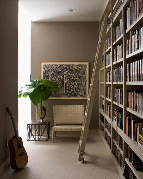 always liked the idea of tall book shelves covering an entire wall