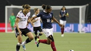 Marie-Laure Delie of France controls the ball against Annike Krahn of Germany