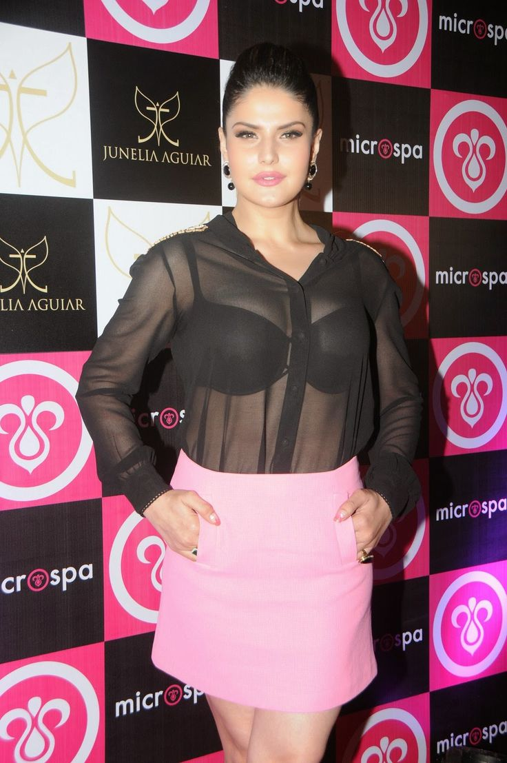Zarine Khan Flashing Black Bra From a Black See-through Top At The Microspa Launch Event In Mumbai more @ http://www.luvcelebs.com