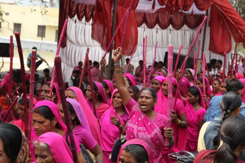 India's Pink Gang, the largest women's vigilante group in the world, shames abusive husbands and corrupt politicians by going door-to-door clad in electric pink saris and wielding sticks called laathis—the same wielded by local cops when patrolling their beat. Recently, they've gained political clout by winning seats in the panchayat elections—the equivalent of American municipality elections.