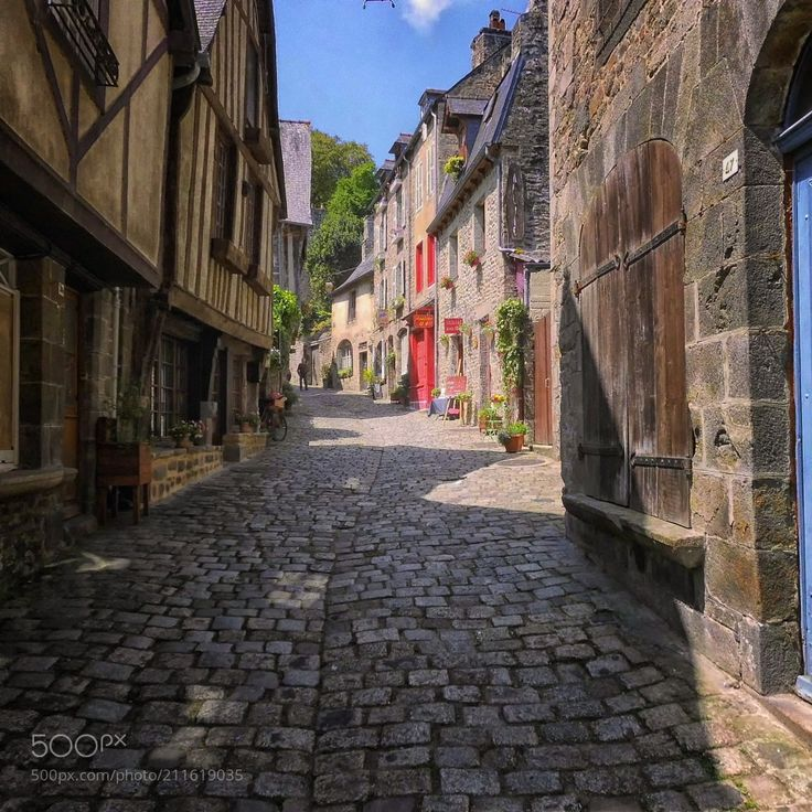 A old street in Dinan by Bilderreisen from http://500px.com/photo/211619035 - Dinan is a town in western France and sub-prefecture of the department of Côtes-d'Armor with 10919 inhabitants (as of 1 January 2014). This Breton city is surrounded by an impressive ring on walls. Strategically located for the traffic between Normandy and the northern coast of Brittany Dinan was built mainly on a hill. The old town is about 75 m above the River Rance which flows north and flows into the Channel…