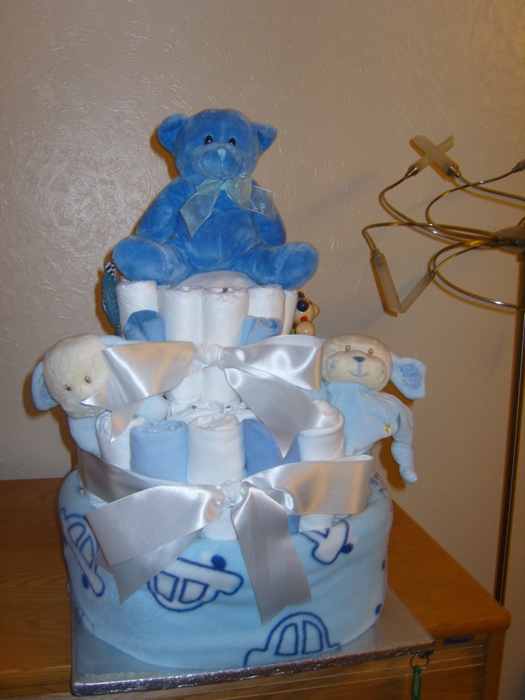 My first attempt at a nappy cake for the birth of a friend's baby boy. Really enjoyed making it!