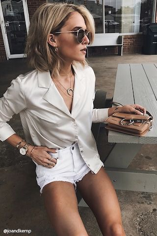 A satin woven shirt featuring a notched collar, long sleeves with buttoned cuffs, a button-down front, and an oversized fit.