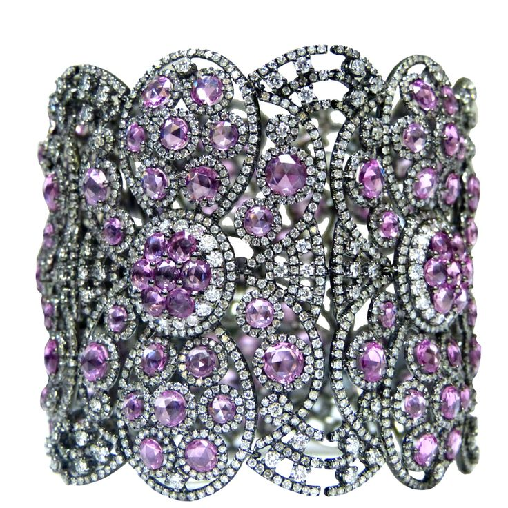 "Handmade antique style ""soft bangle"" bracelet set with 34.32cts. of Natural Pink Sapphires and sprinkled with 24.95cts. of white, round brilliant cut diamonds, approximately F/G in color and SI clarity.  1stdibs"