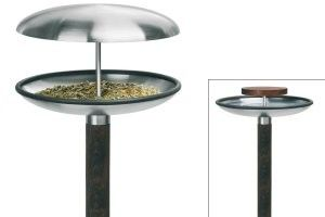 Beautiful stainless steel contemporary bird bath / feeder. Freestanding design with wooden pole with pointed tip for pushing in to the ground wherever you want.So attractive all year round.In summer a bird bath, in winter a covered feeder with its removable stainless steel lid. Easy to cleanHeight 122-131 cmDiameter 25cmFrom Blomus in Germany