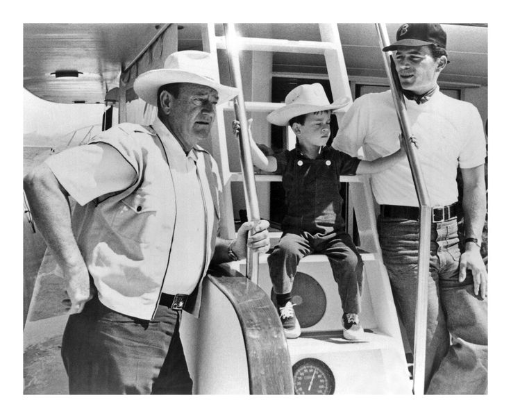 John, Ethan, and Patrick Wayne in 1965.