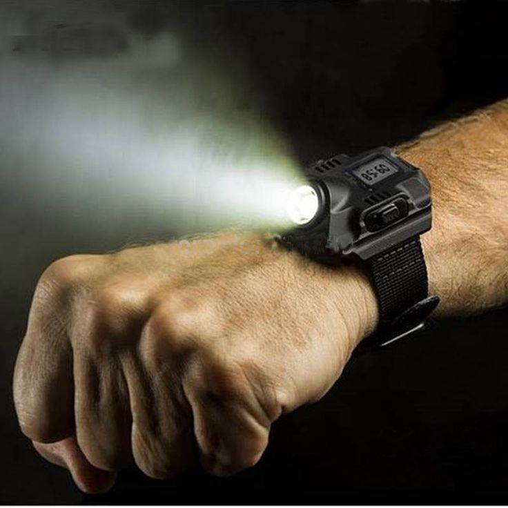 This Tactical Wrist Watch has several functions. It can be used to light up your path when walking in the dark, serve as a torch light, provide an SOS signal, and tell time. It is made from aluminum a