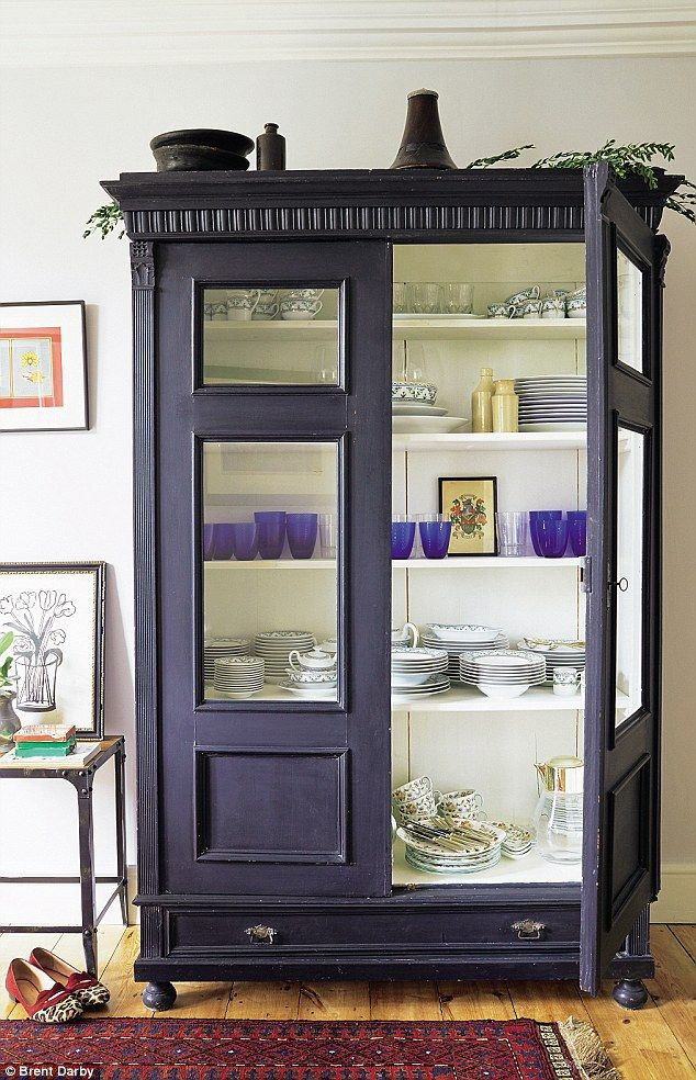 A 19th-century Dutch cabinet from Phoenix (phoenixongolborne.co.uk) houses the couple's wedding china – a mix of Royal Doulton and Limoges porcelain. For a similar finish, try Annie Sloan's Chalk Paint in Charcoal (anniesloan.com)