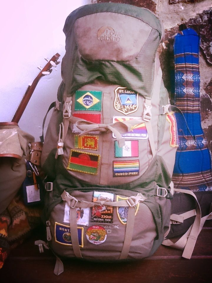 My home and family when travelling. Backpack, flag patches, ukulele, charango