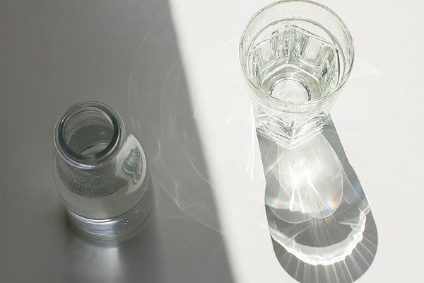 Bottle and glass of water with shadows by Anastasy Yarmolovich #AnastasyYarmolovichFineArtPhotography  #ArtForHome #Food #Drink