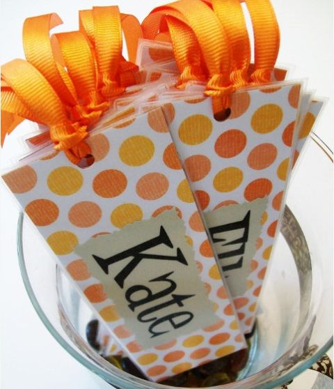 """Kristen says, """"Wouldn't these make cute """"Welcome to Kindergarten"""",  gifts for your kiddos?  Easy to make!  Just get some scrapbook paper, glue on their name, laminate, and attach the ribbon!  I'll be giving these to my kiddos at our Back to School night""""."""