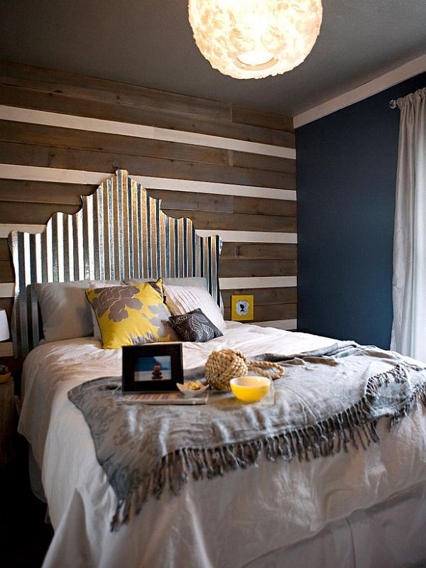 Who knew that metal roofing could be so stylish? This headboard was created by cutting a piece of corrugated tin. This  $30 headboard is anything but ordinary.