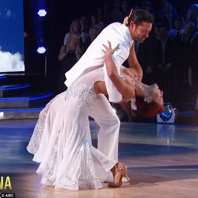 All white: Noah Galloway and partner Sharna Burgess danced in all-white outfits