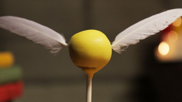 But, if you can't get your hands on the authentic version, try the next best thing: golden snitch cake pops!