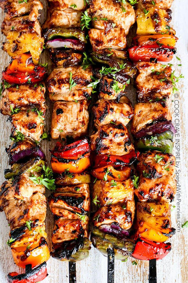 These Grilled Hawaiian Chicken Kabobs have tender juicy chicken layered with a rainbow of veggies in a tangy Pineapple Honey BBQ Sauce!