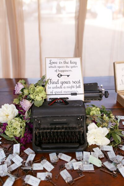 """Love is the key which opens the gates of happiness, find your key/seat to unlock a night full of great memories."" For a vintage wedding decoration get an old typewriter and make you own sign to put in it. Attach seating tags to keys for great a great wedding favor. These keys are also bottle openers. Vintage & Victorian Style Wedding at Serra Plaza 