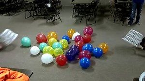 Hilarious: Hungry Hippo game with teens, balloons, baskets and rollerskates.
