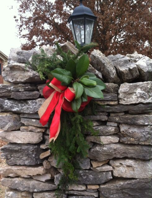 Christmas Decoration - Neighborhood Entrance - Greenery, Burlap, Red Deco Mesh, and Red Ribbon.