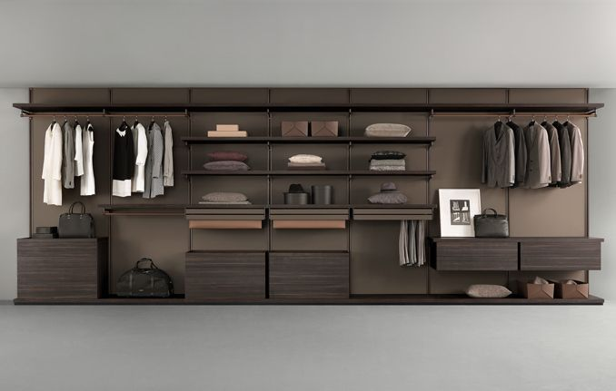 Dress bold, walk-in closet with shelves, cabinets and back panels in melamine larch coal. Cloth hangers coated with regenerated castoro leather. Pull out accessories with brown aluminum structure and mat lacquered caffè glass fronts and regenerated castoro leather coating