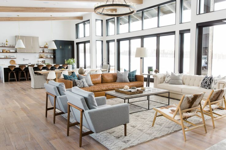 Gorgeous living space! Love the use of wood and neutrals. Medium brown leather, gray, cream. And so many windows!